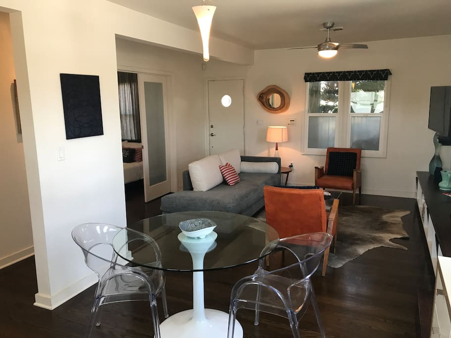 The orange chairs shown are the current chairs in the apartment, much more comfortable than the small chairs in the other photos!