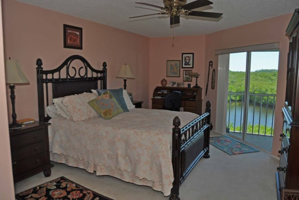 Master Bedroom with a Water View and Lanai Access