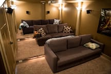 Includes theater room with a sofa bed