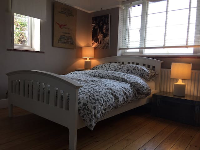 Spacious double bedroom in period family home