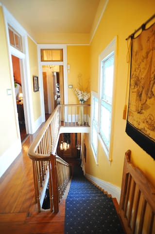 The front upper hallway provides access to the Solarium Suite and the Bride's & Groom's Rooms.