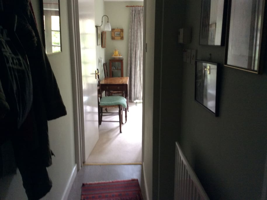 From passage to bathroom showing eating area
