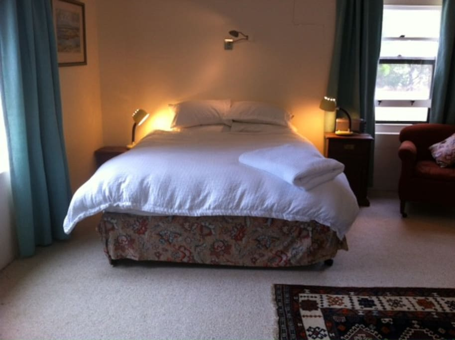 A comfortable queen bed. Choice of doona or blankets.