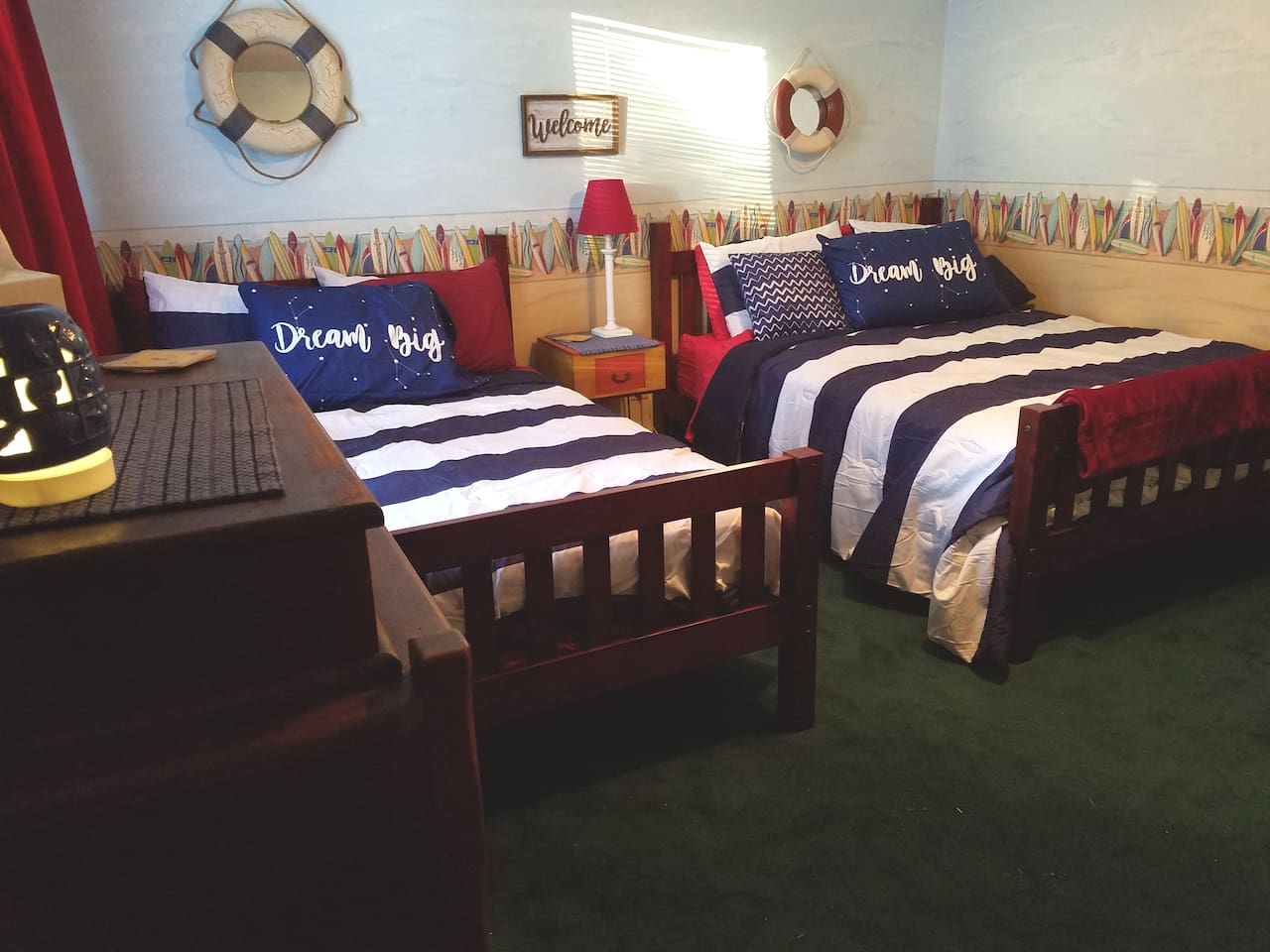 Surf's Up is a fun room. Fruit & water welcome upon arrival, full bath, rec room, 24/7 coffee, + daily breakfast spread. Sleeps 4, w/ space to add a Pack n Play if needed. Need more room consider also reserving the adjacent Wild Side guest room.