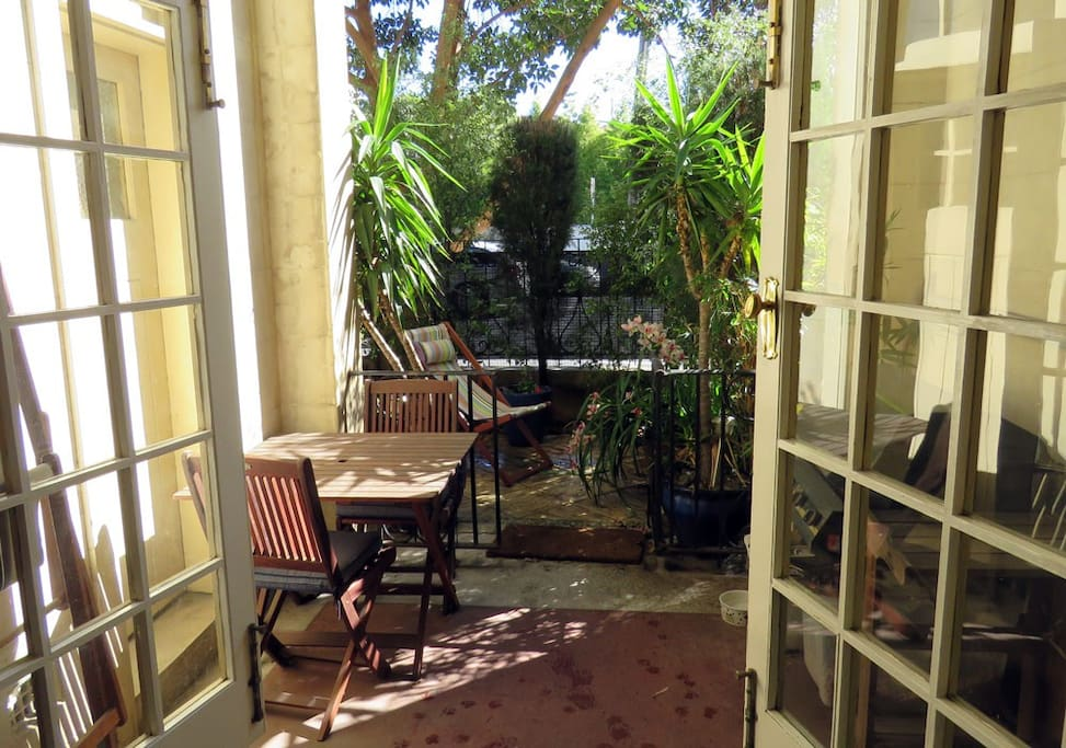 There is a lovely portico leading to a good size courtyard