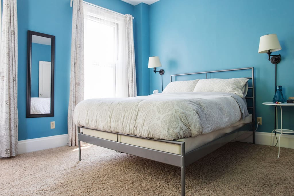 Soft bedding, reading lights, ceiling fan, draperies to control the amount of light in the room