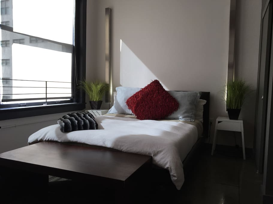Comfortable bed with soft decorative linens