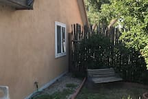 Fenced backyard with patio area