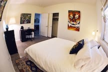 Bedroom #2 with queen bed and work station.