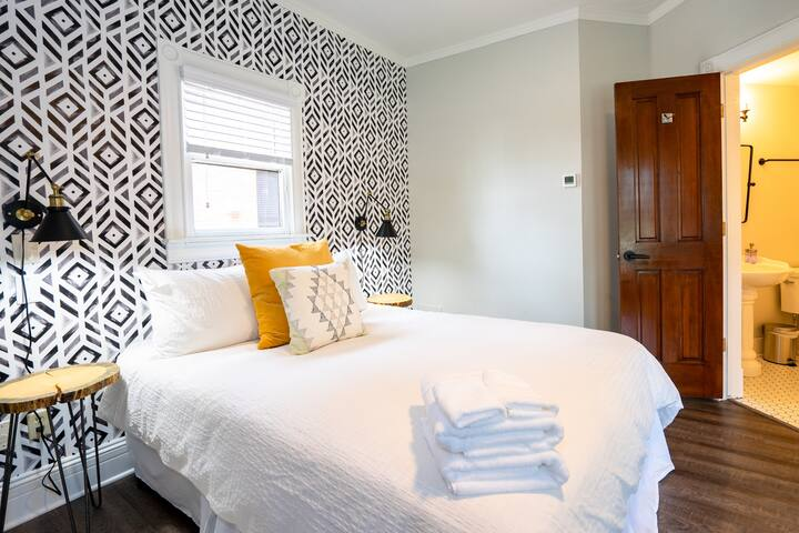 Next to the bed, guests will find the private bathroom.