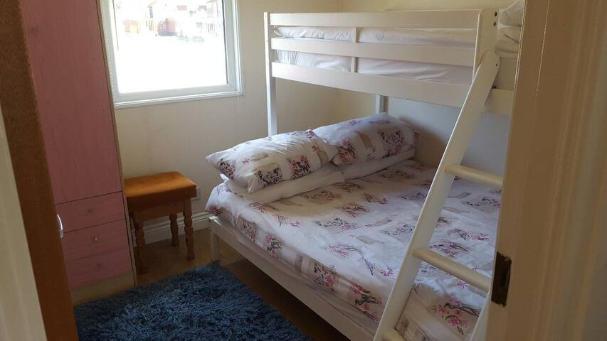 Bedroom with double and overhead single bunk