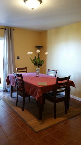 Dining area in kitchenette with sink, refrigerator, microwave, toaster and stocked Keurig coffee maker