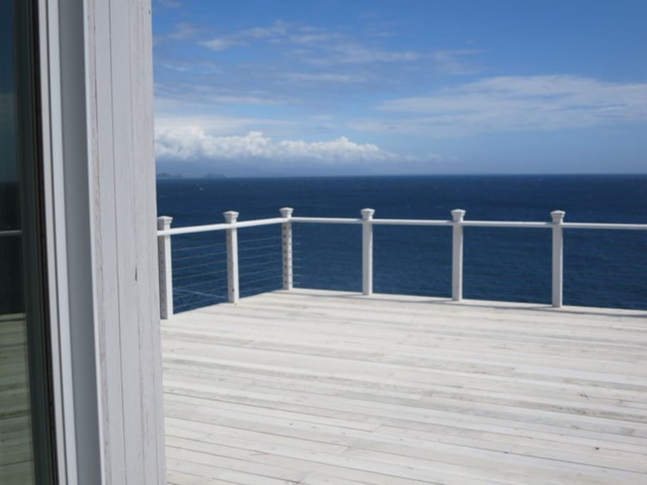 Large deck surrounds the guesthouse