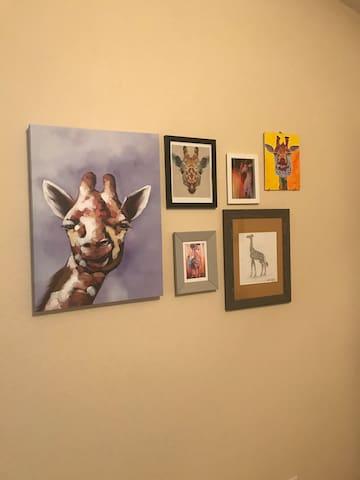 Giraffe Art adorns the room