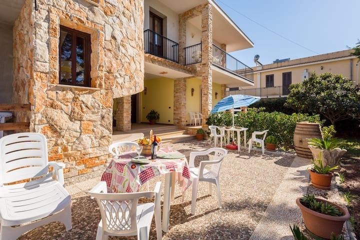 Maria's house near the sandy beach, parking & wifi