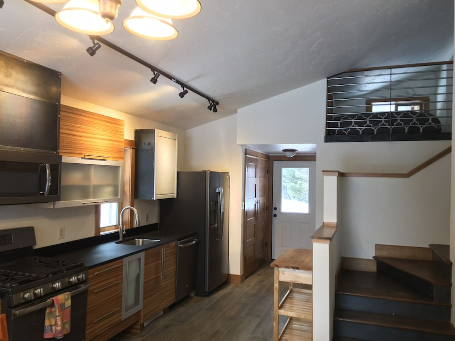 Renovated State of the Art Kitchen. Sleeping loft in upper right corner