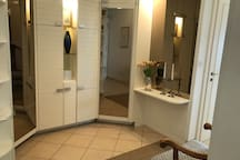 Spaceous entrance with cupboards.