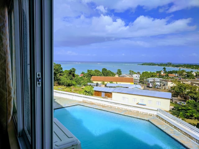 One bedroom apt overlooking the pool and the bay