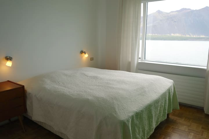 Bedroom 1 with a double bed and large closets. Plus a magnificent view.
