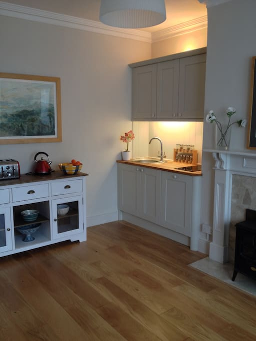 A modern open plan living room/kitchen with plenty of character and style.