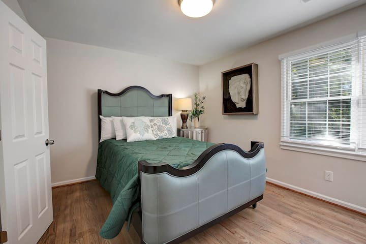 The third bedroom with a soft comfortable queen bed will have you feel refreshed and ready to explore the city