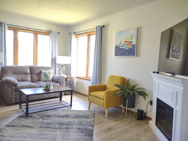 Sit down and relax in the yellow accent living room that flows into the dining area. High def tv, games and wifi.