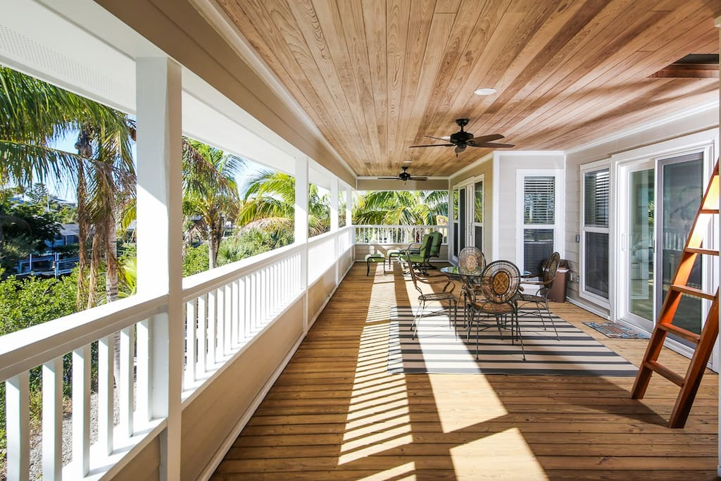 Relax on the expansive porch amid the swaying palms