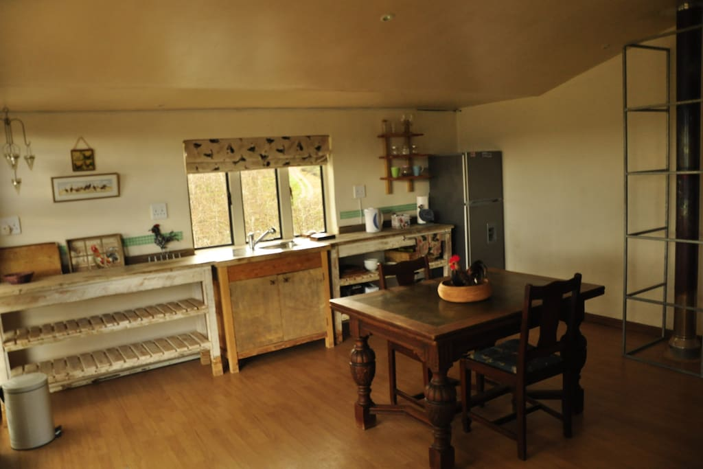A view of the kitchen area and orchards in the background.