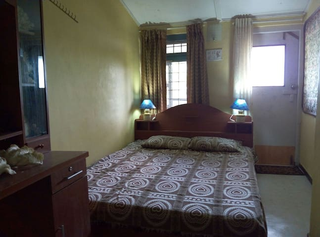 Bedroom 4 on level 1 with  double bed with attached full bathroom level 1.