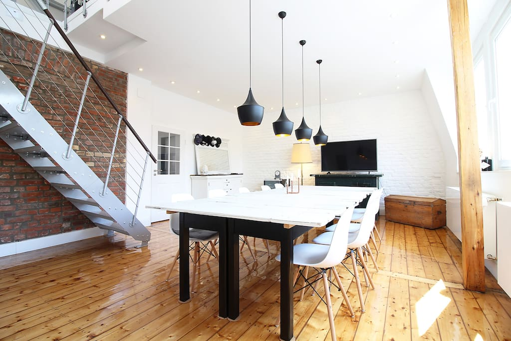 The bright dining room in the first floor offers a big dining table.