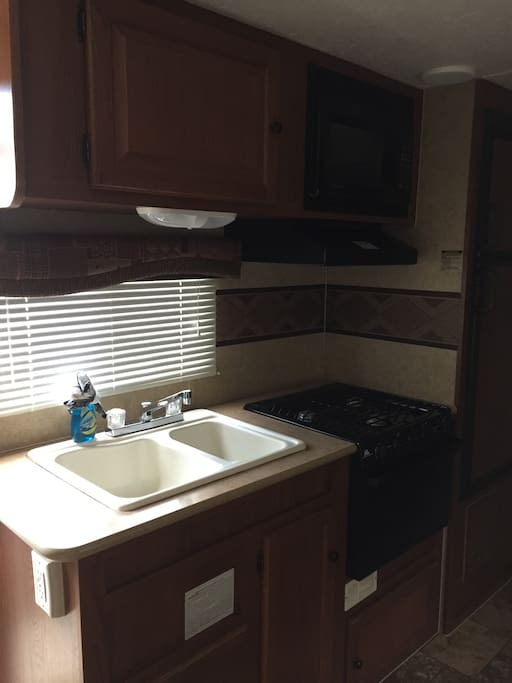 Your full Kitchen with microwave, oven, stovetop.