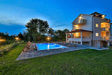 villa with pool on a large fenced plot