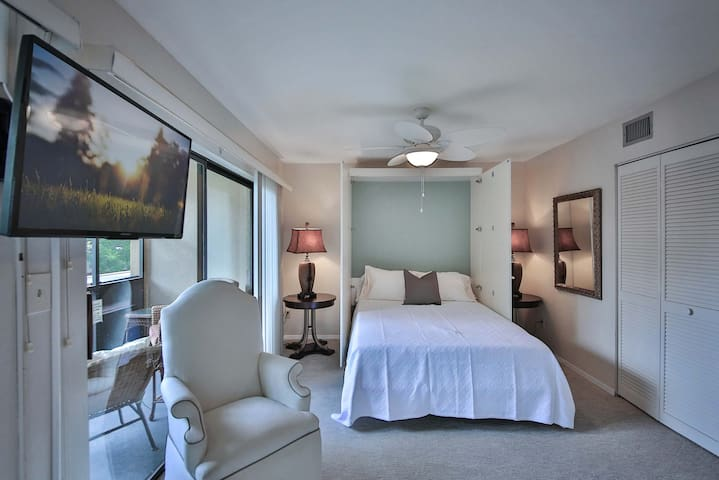 This room has a folding door that unfolds across the room for complete privacy with the beautiful view on the lanai or swing the TV to face the bed because the other bed room has its own TV.