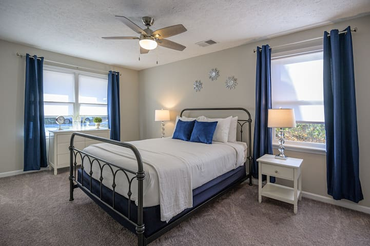Oversized master bedroom with queen size bed well suited for two.