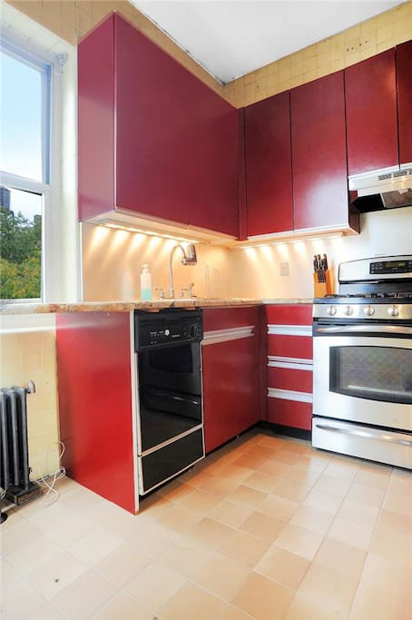 Kitchen with double oven, dishwasher and fridge.
