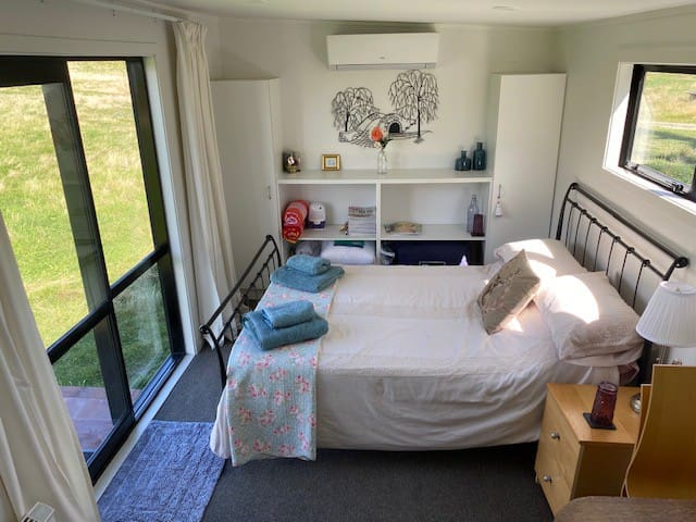 Queen bed and clothes cupboards