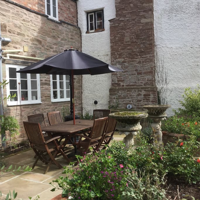 Lovely outside courtyard with patio heater.
