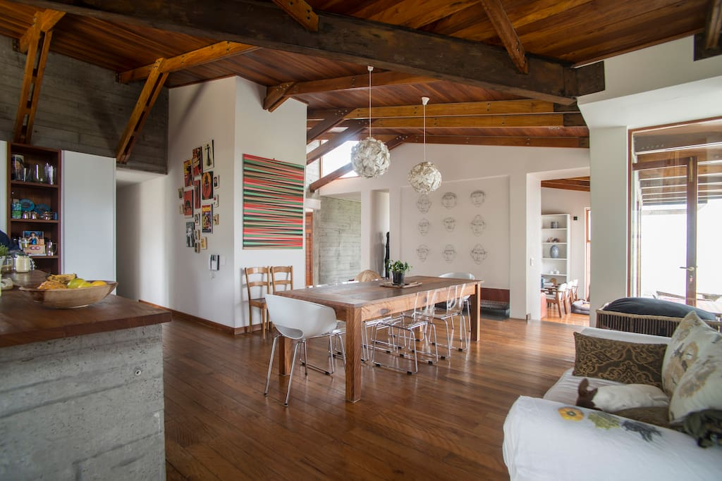 Spacious dining area with floor to ceiling viewing windows and open plan chef's kitchen