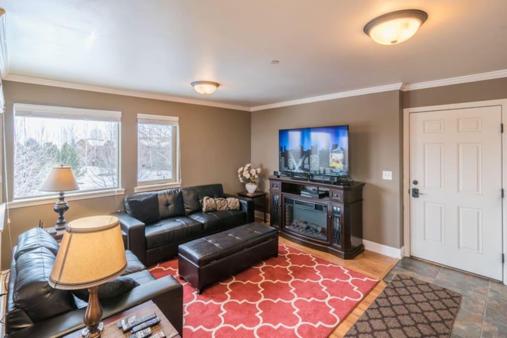 Comfortable living room with big screen tv and roku