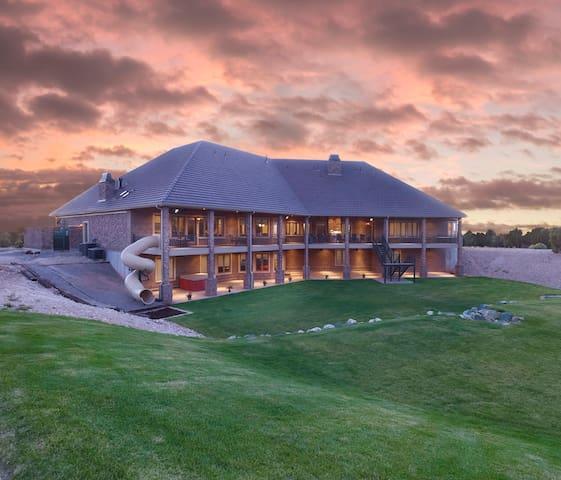 BEAUTIFUL lodge, sleeps 62+! Plus 40-acres of FUN!