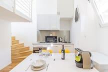 Modern kitchen with diner area