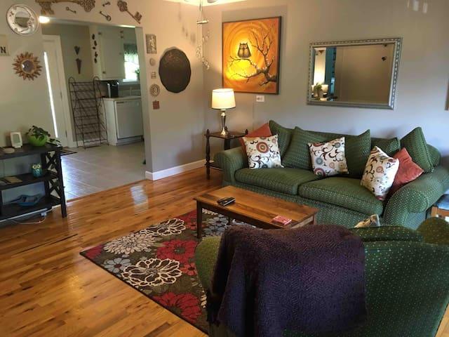 Living room, from front door.  Kitchen, too.