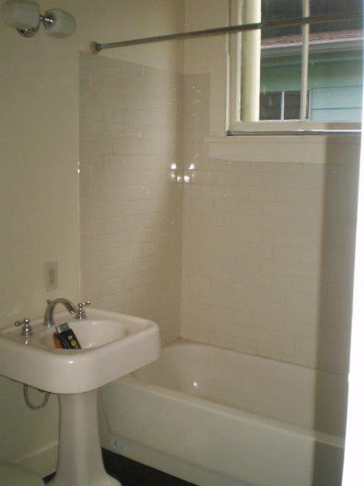 Shower and tub with vintage fixtures (but the renovation is new!)