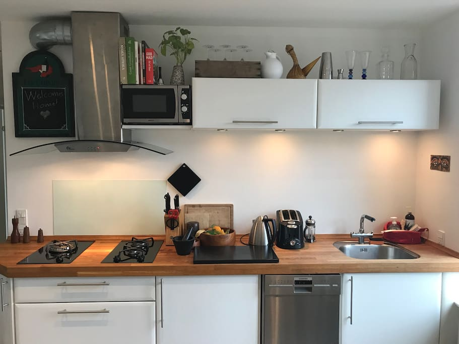 Modern kitchen area with all utilities.