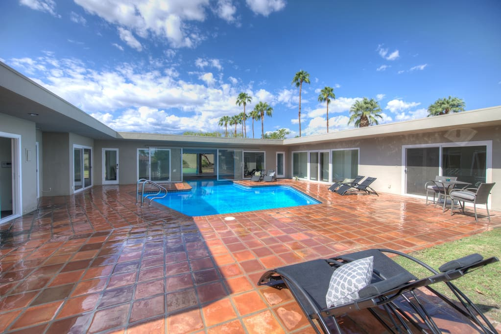 Take a dip in the private pool during your stay at this vacation rental house!