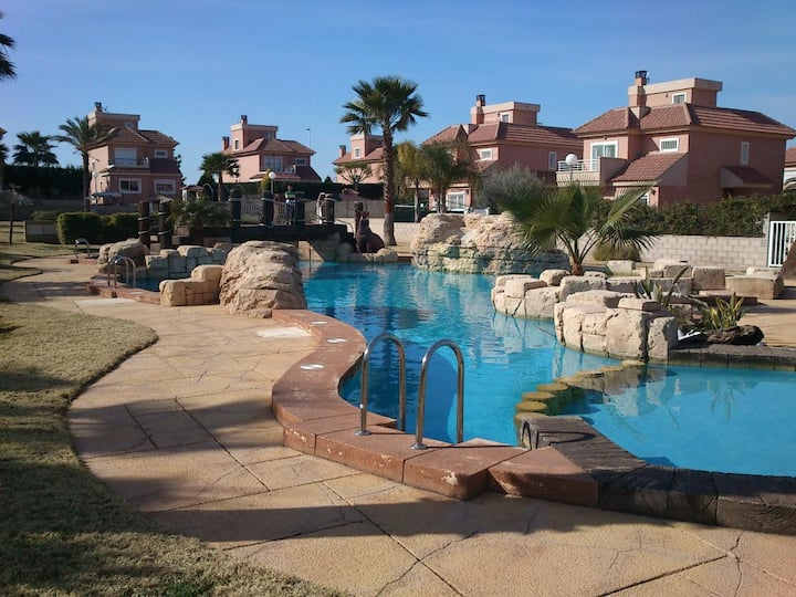 Bright, spacious villa, with wrap-around gardens