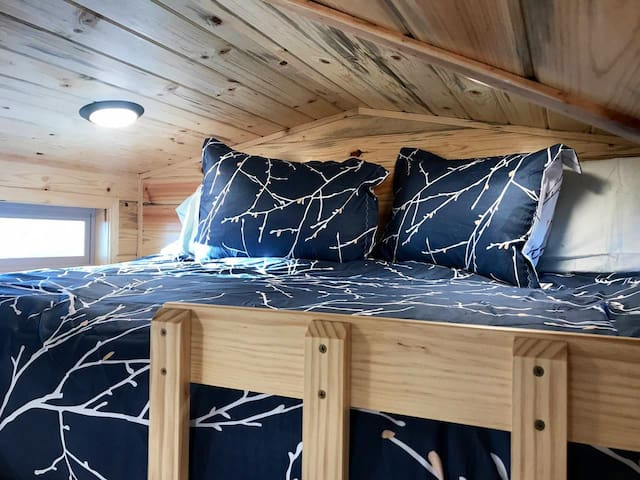Full size bed in the cozy loft