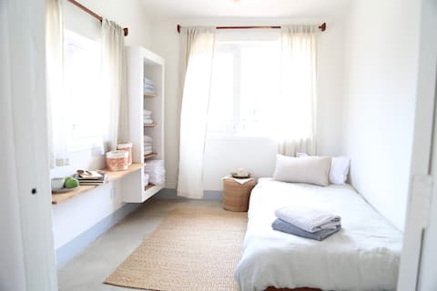 Lele room, Our smallest, brightest spark! Our coziest room packs in the lot, sleep space, work space, lounge space, sprawl space...