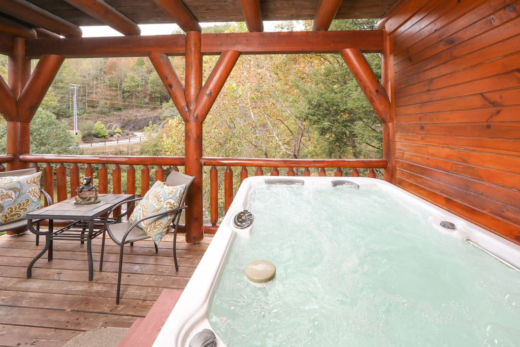 Charming cabin retreat with a luxurious outdoor hot tub overlooking Cove Creek. Professionally managed and maintained by TurnKey Vacation Rentals.