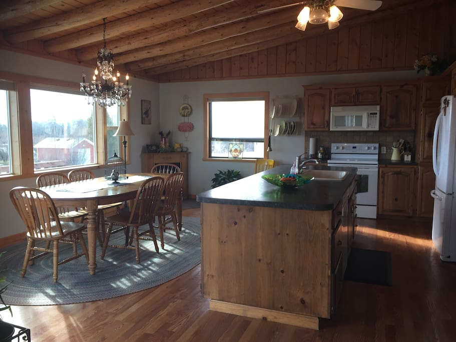 Spacious kitchen/dining room, with scenic views of the area.